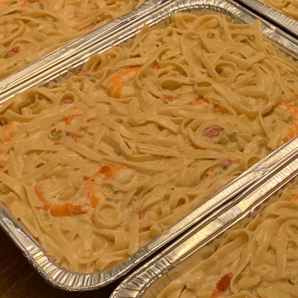pans of linguini with creamy sauce and shrimp