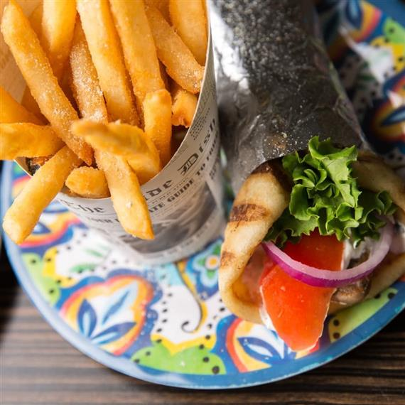 gyro with fries on plate