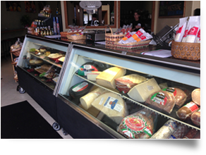 deli case with various types of meats, cheeses and other items on display