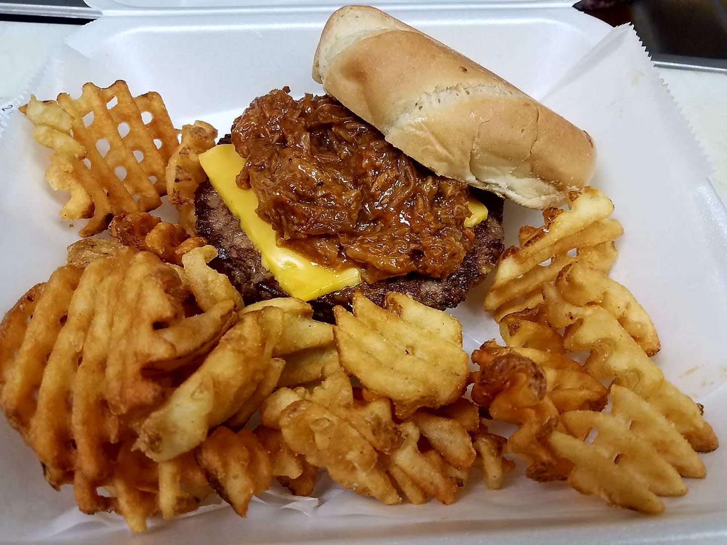 cheeseburger with pulled pork served with waffle fries