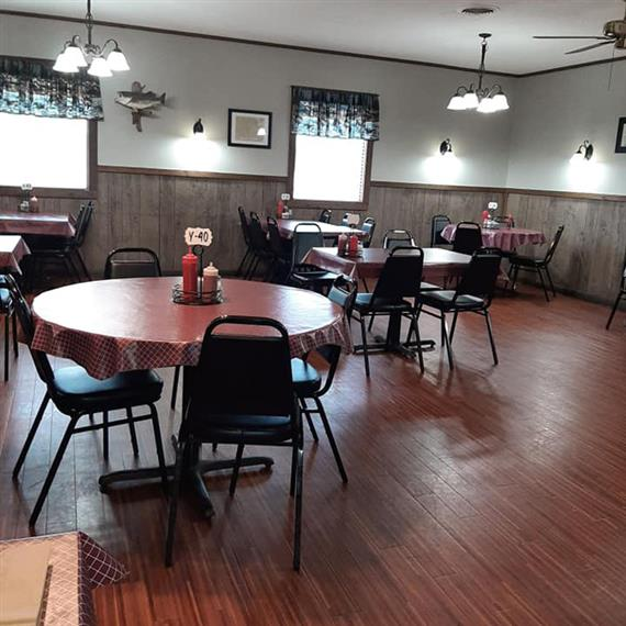 The dining area of Catfish Kettle with set tables and chairs