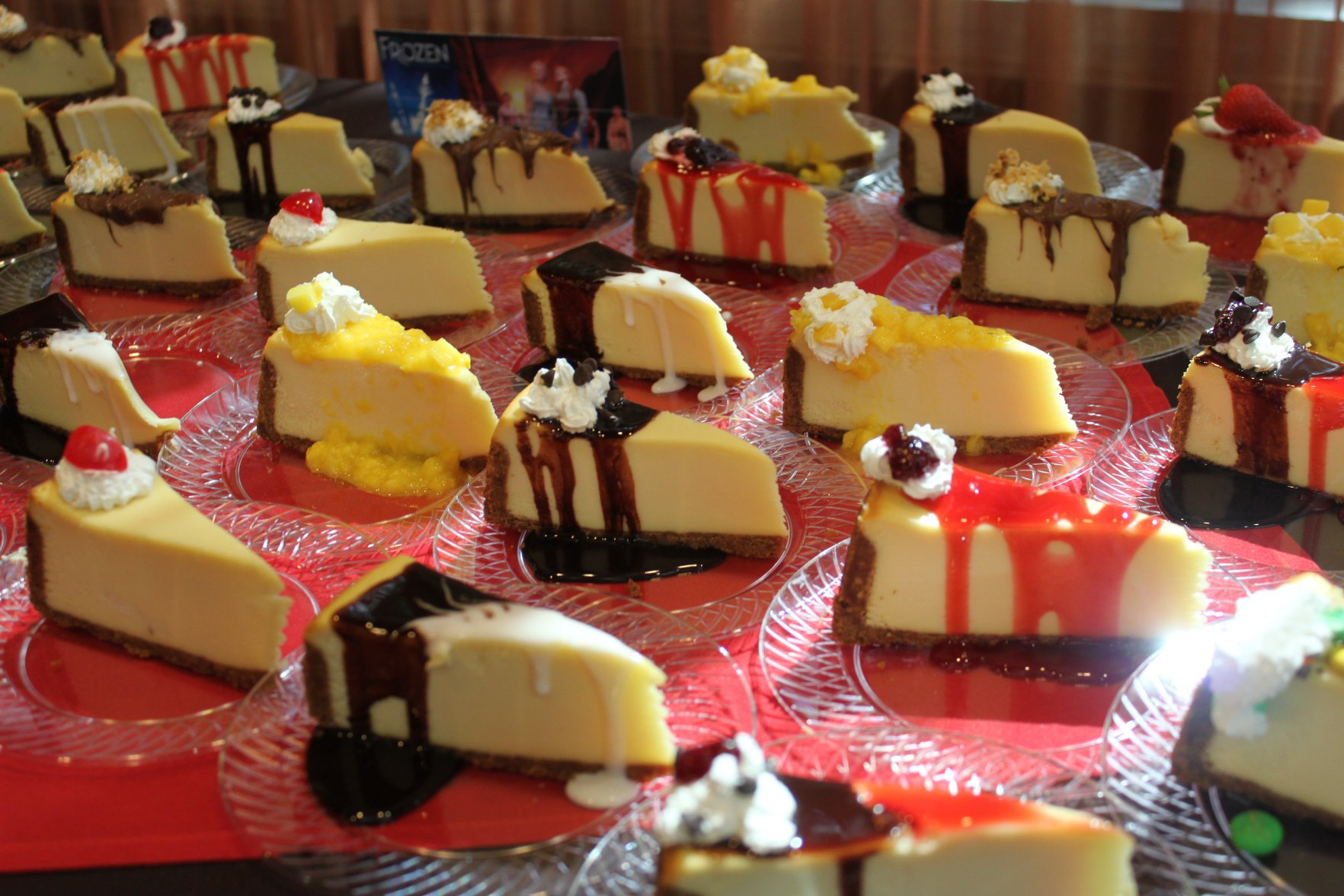 pieces of cheesecake on a table with various toppings