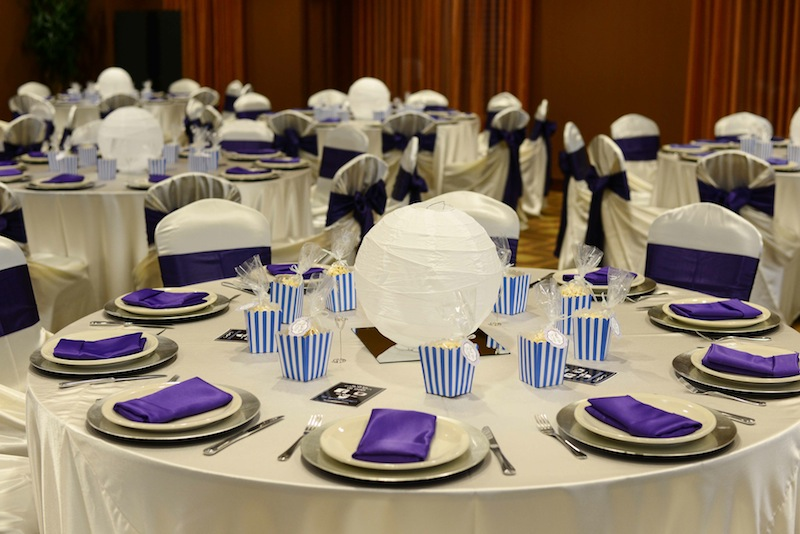 tables set for an event with paper lantern centerpieces