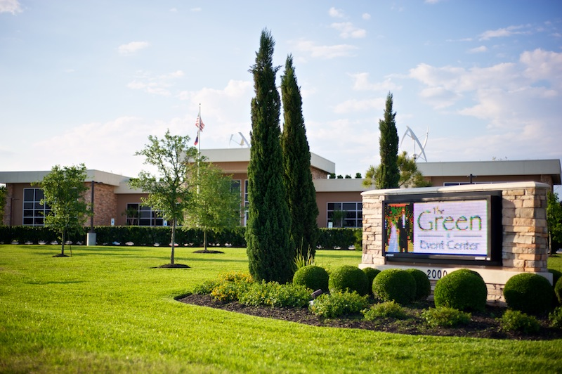 Sign and front view of the Green Event Center