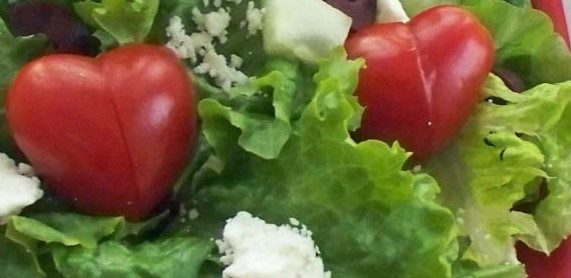 house salad with heart shaped tomatoes