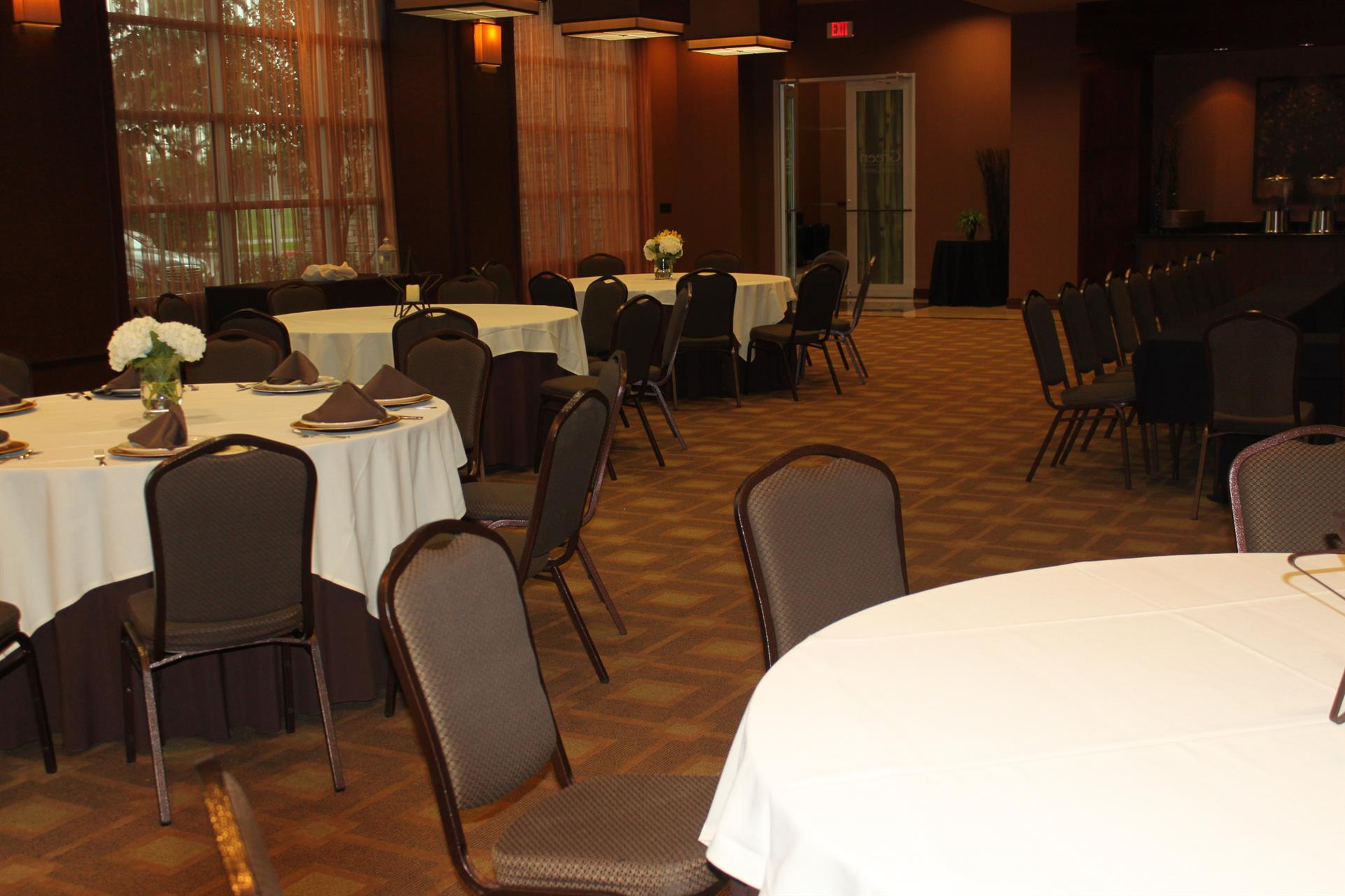 Corporate event space with round tables and chairs