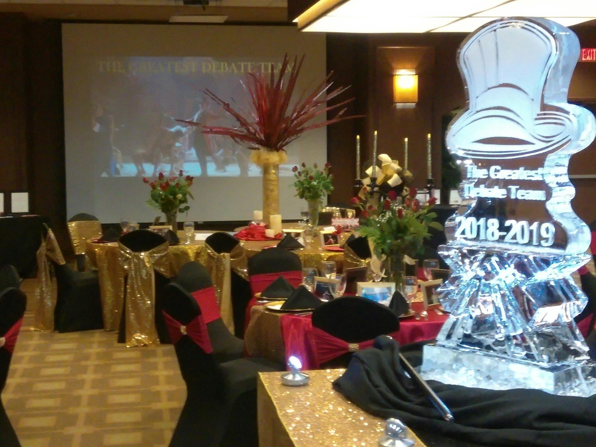 event space decorated for a debate team event with an ice sculpture