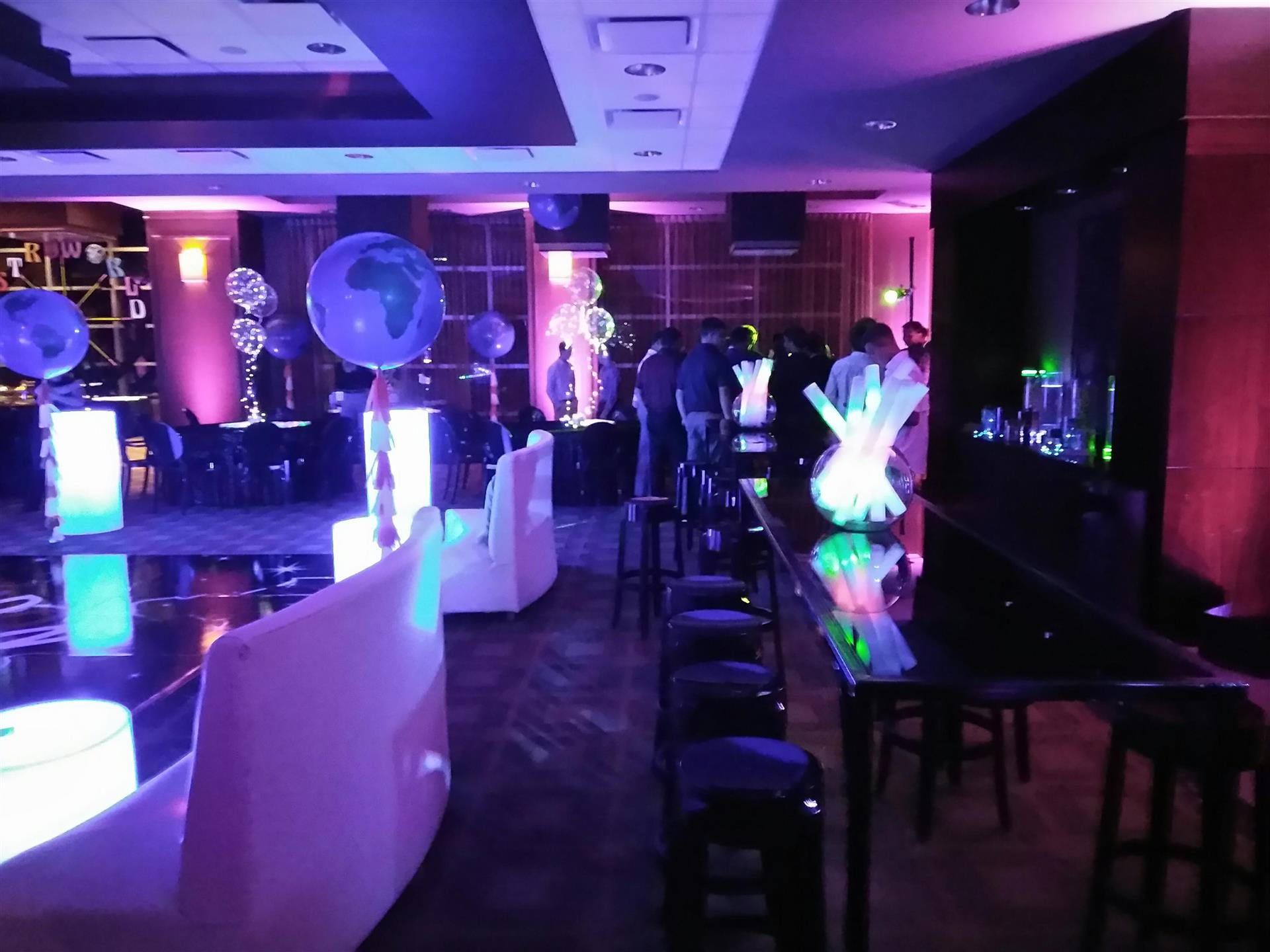 glow party set up with globe balloon and light wands