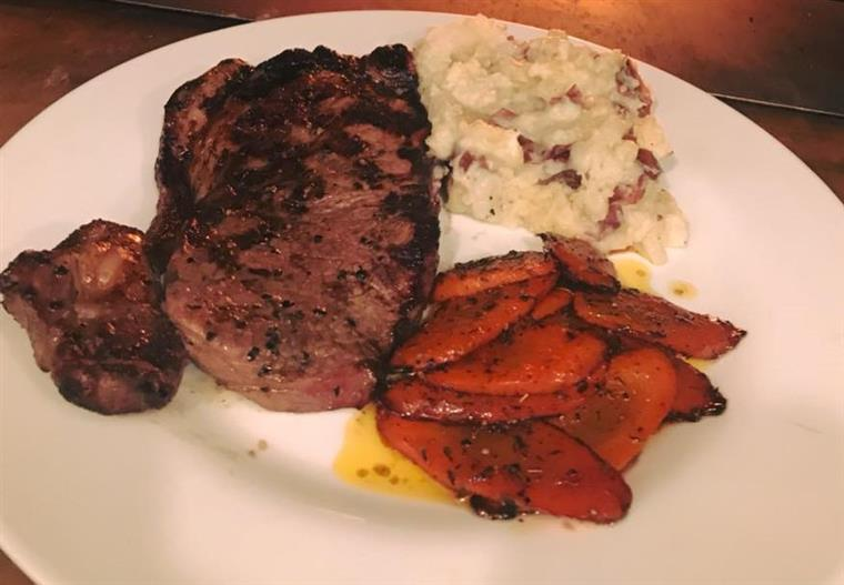 grilled steak with mashed potatoes and carrots