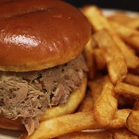 pulled pork sandwich with french fries