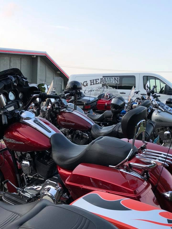 hog heaven delivery van parked next to motorcycles