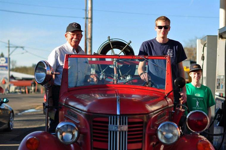 staff members with old fashioned hot rod