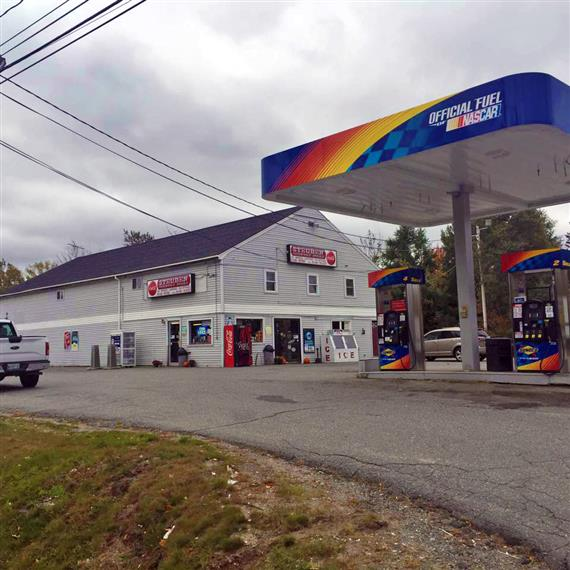 Front outside view of Steuben's Country Store, in front of a Gas station