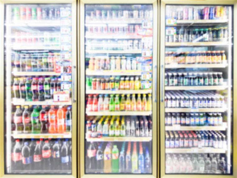 three refrigerator doors with assorted beverages inside