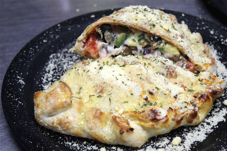 Big Daddy Deluxe Calzone: Sausage, pepperoni, mushrooms, onions, green peppers, & black olives with pizza sauce & mozzarella.