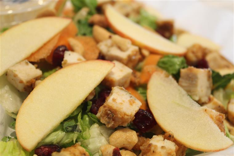 Grandma's Off the Waldorf Salad: Fresh sliced apple, celery, & carrots coated in lemon juice & mixed with fresh Romaine, dried cranberries, crunchy cashews & an off-the-charts sweet homemade dressing.