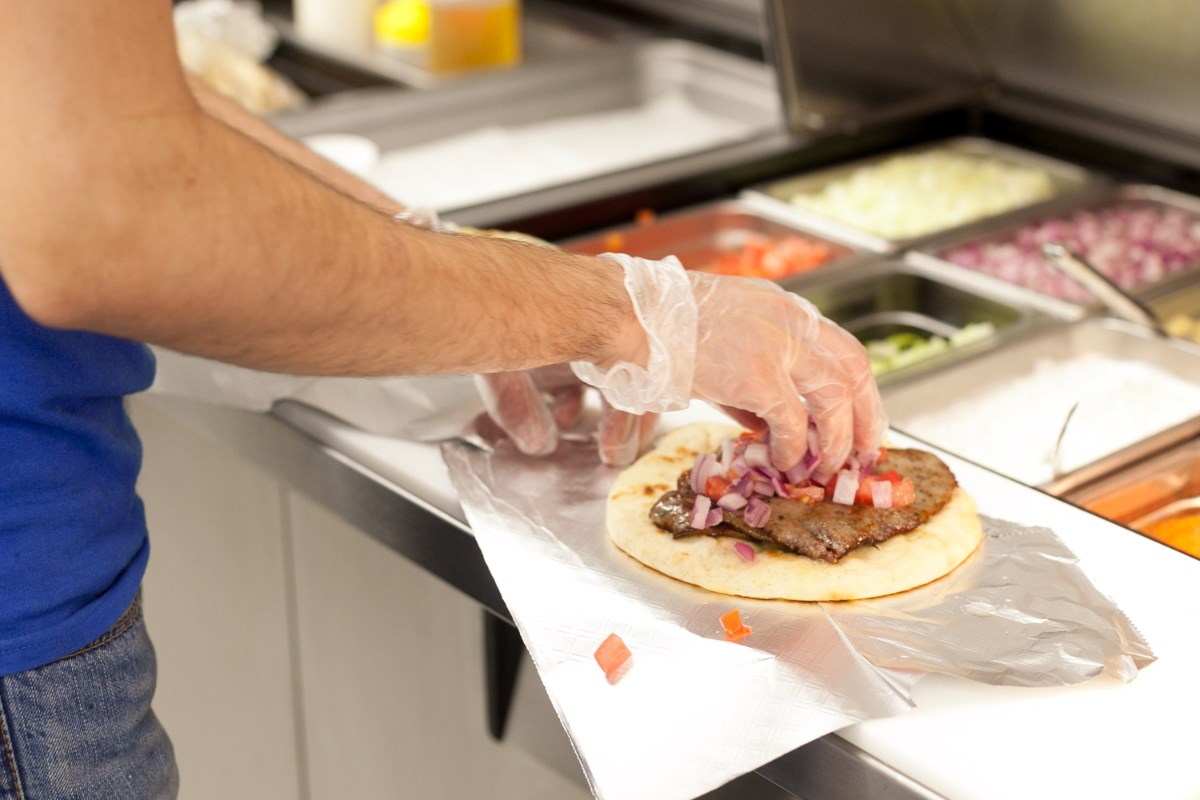 A cook preparing a gyro