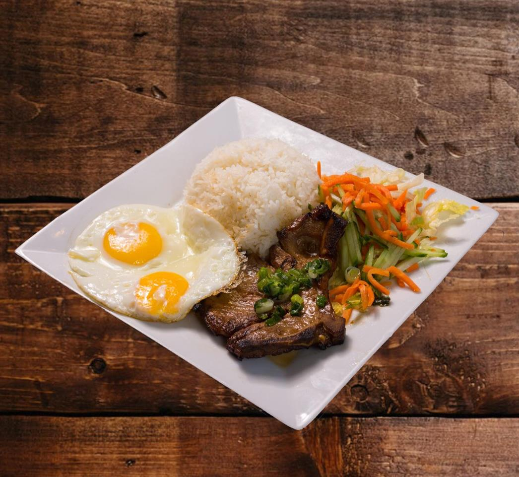 57. Grilled Pork Chop (1) with Eggs (2) on Riice