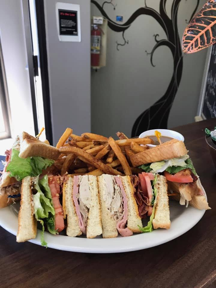 club sandwich with roast beef, turkey, cheese, lettuce, tomato and mayo with fries on the side