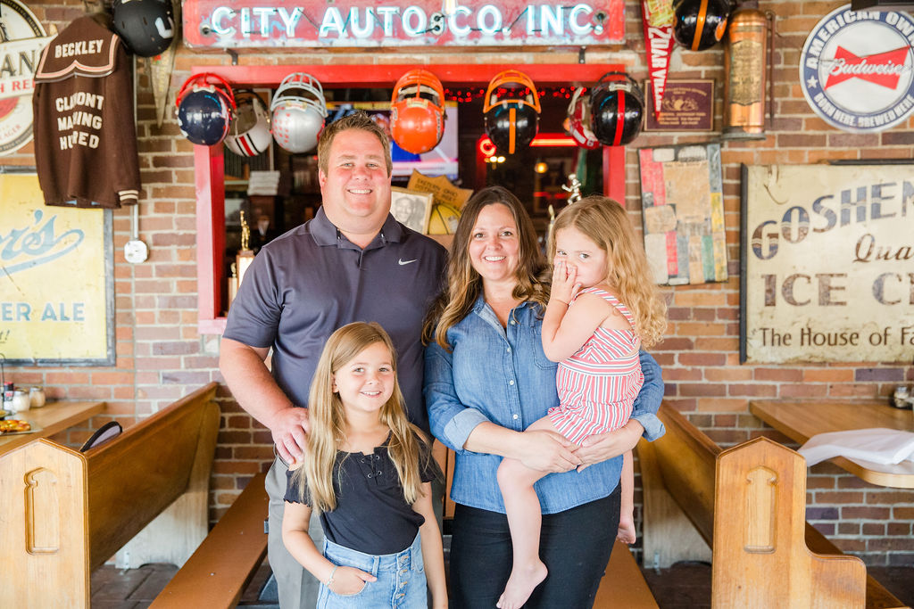 the owners and their daughters inside the building