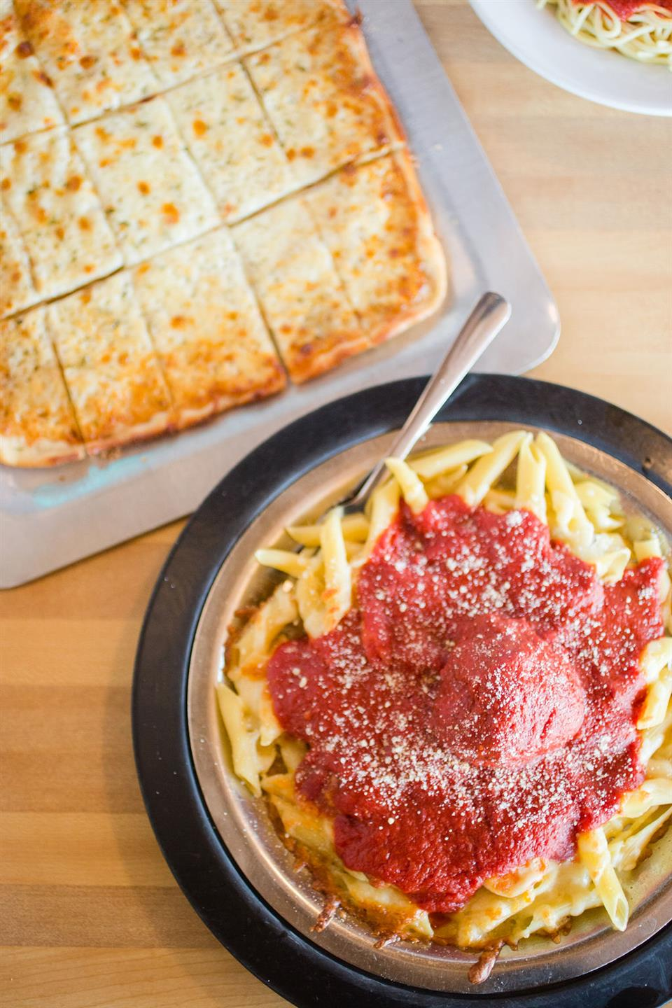 spaghetti with meatballs and a flatbread with cheese