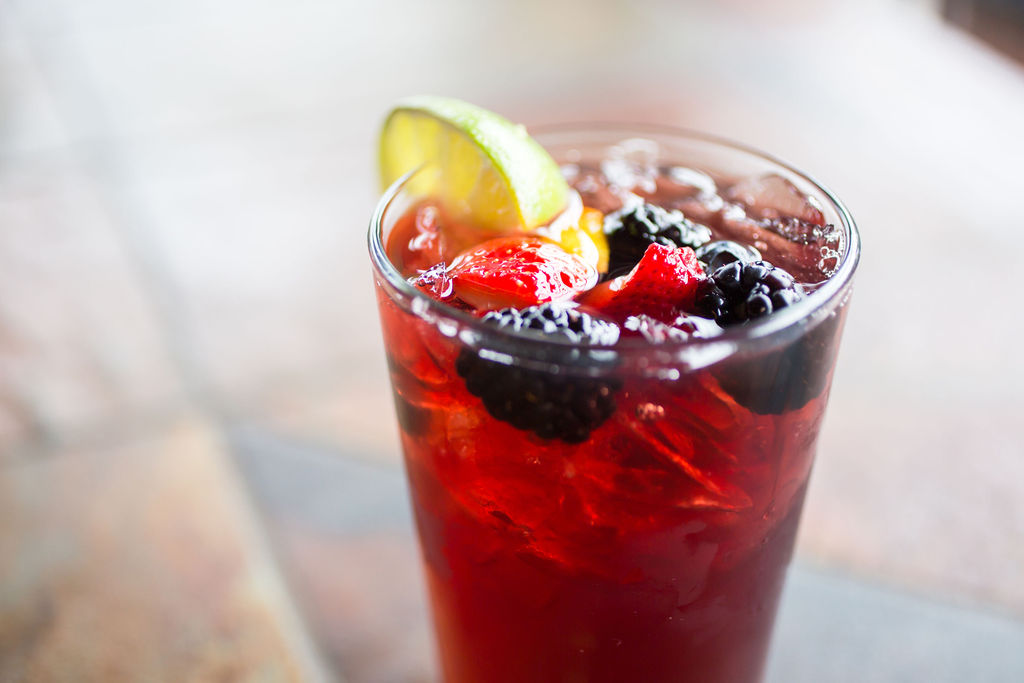 cocktail with berries and lemon