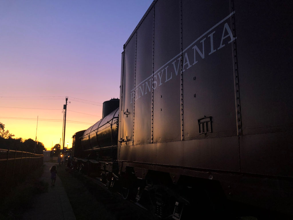 vintage train with view of sunset