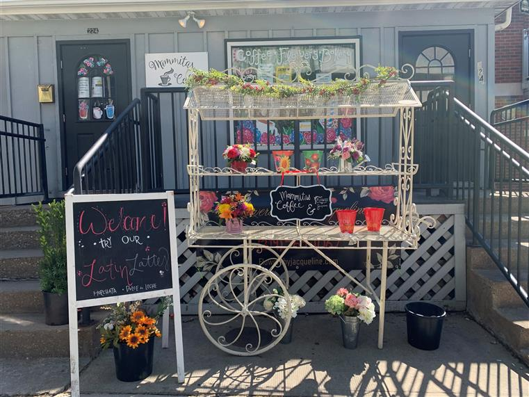 flower cart in front of Mammitas Coffee with chalkboard sign