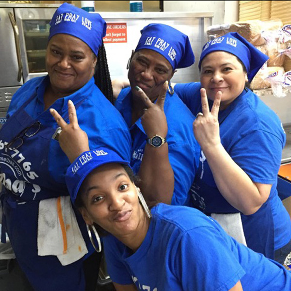 Melba's employees smiling at work