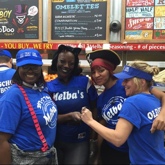 employees at Melba's smiling and working