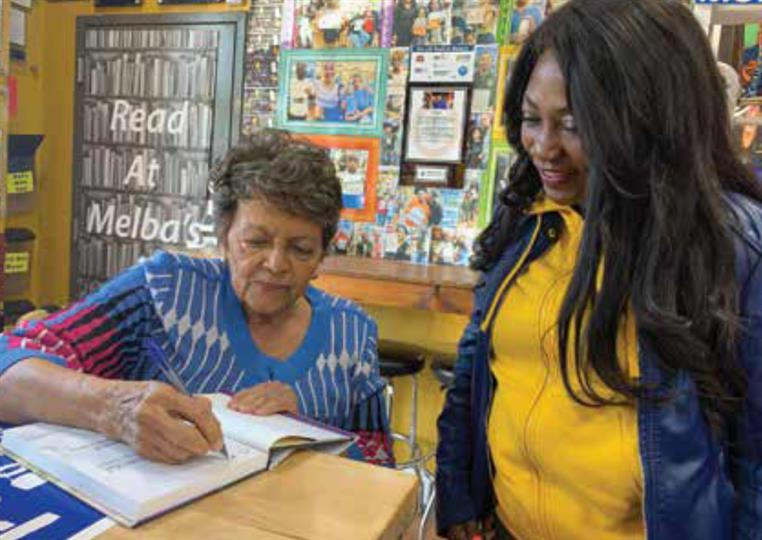 writer signing her book for a fan