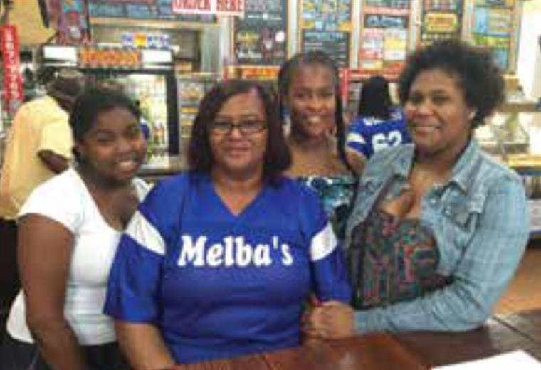 four ladies smiling at Melba's