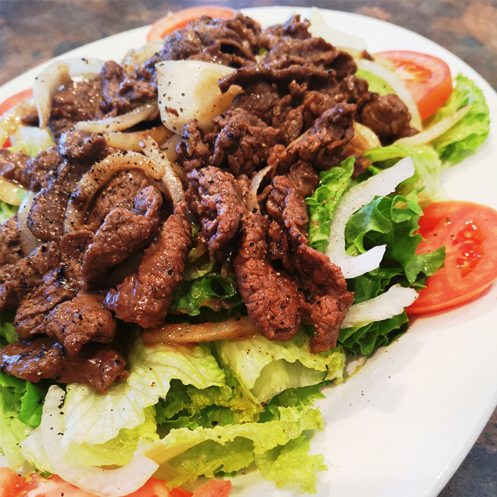 75) Stir Fried Beef on Platter of Dressed Lettuce, Tomatoes & Onions