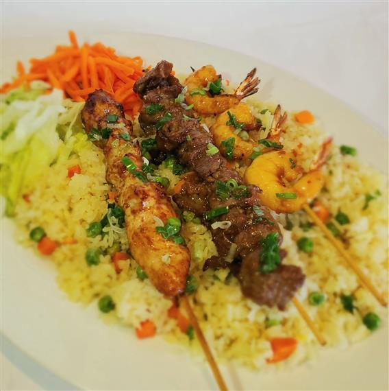 rice with various meats on skewers
