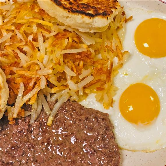 breakfast platter with eggs, sausage and hash browns