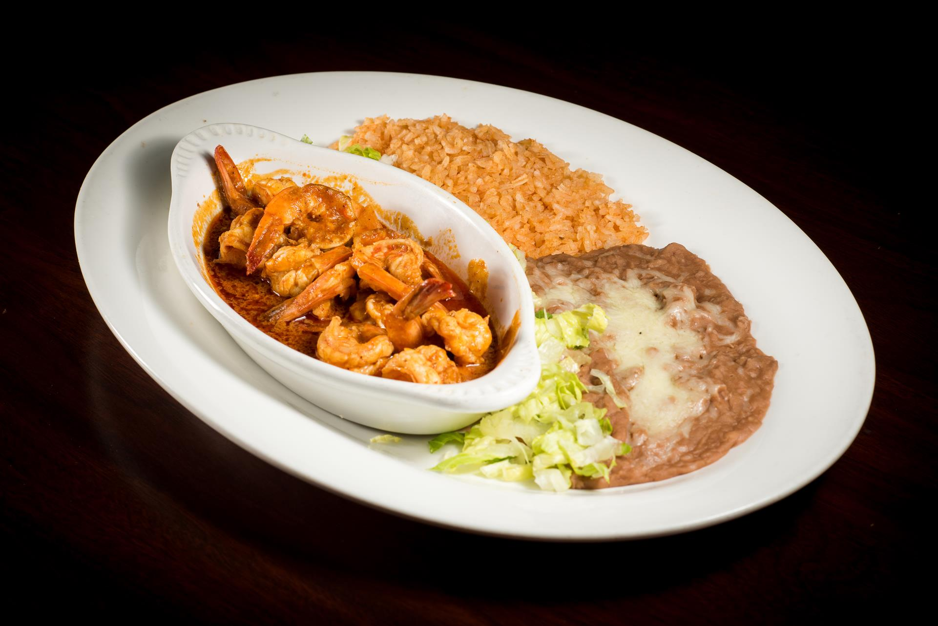 Shrimp A La Diabla: Sauteed prawns in our hot spicy sauce served with lettuce and pico de gallo.