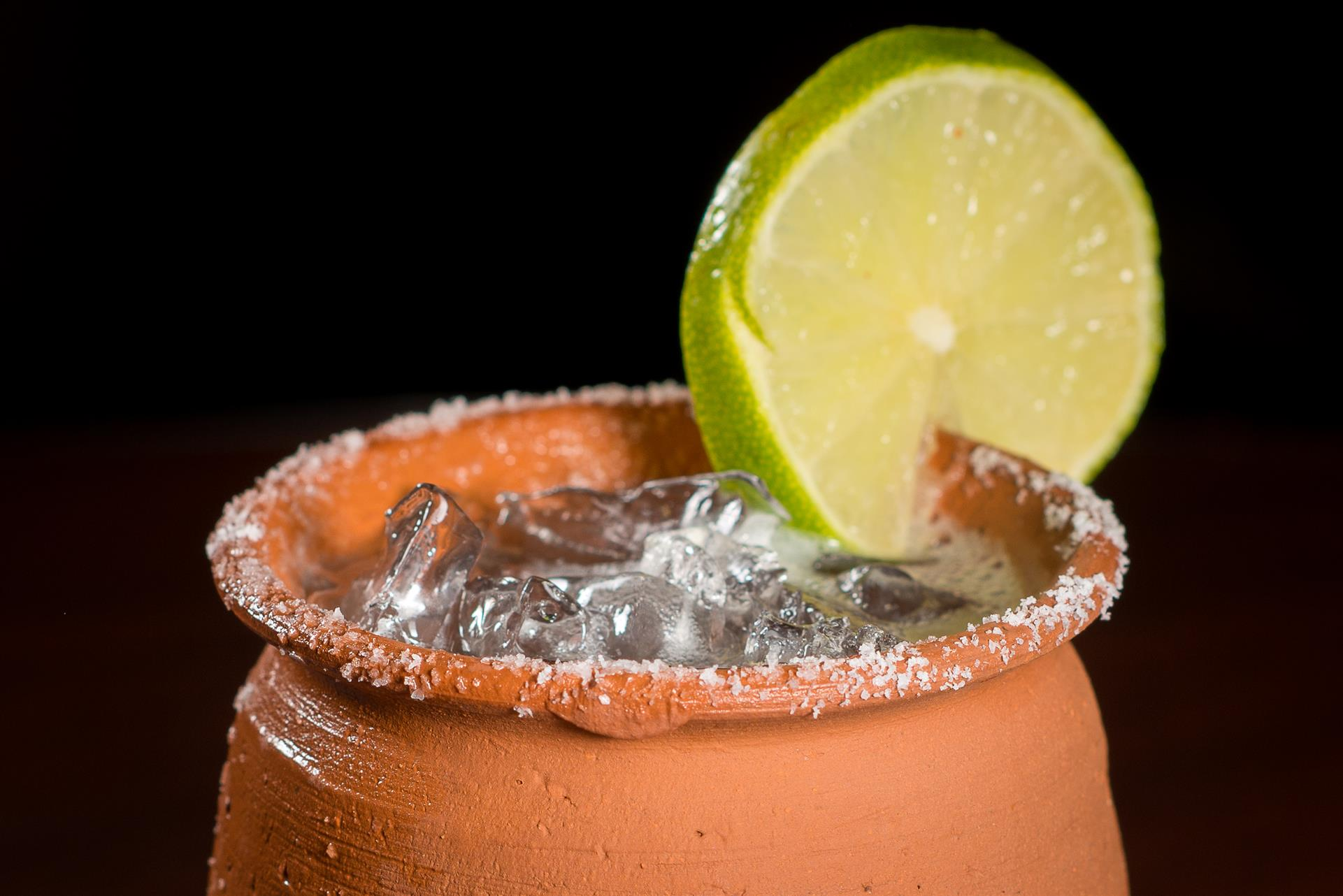 Margarita on the rocks with a lime and salt on the rim