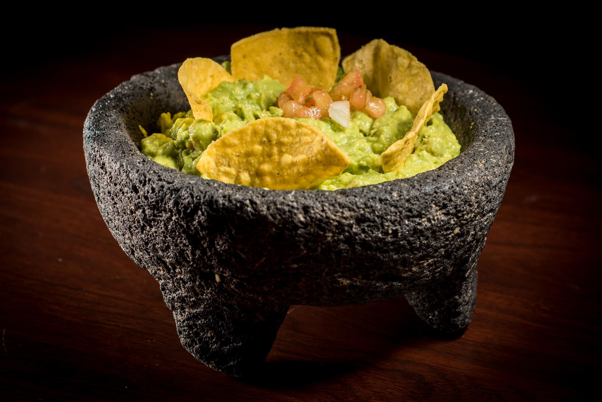 Molcajete with guacamole and chips