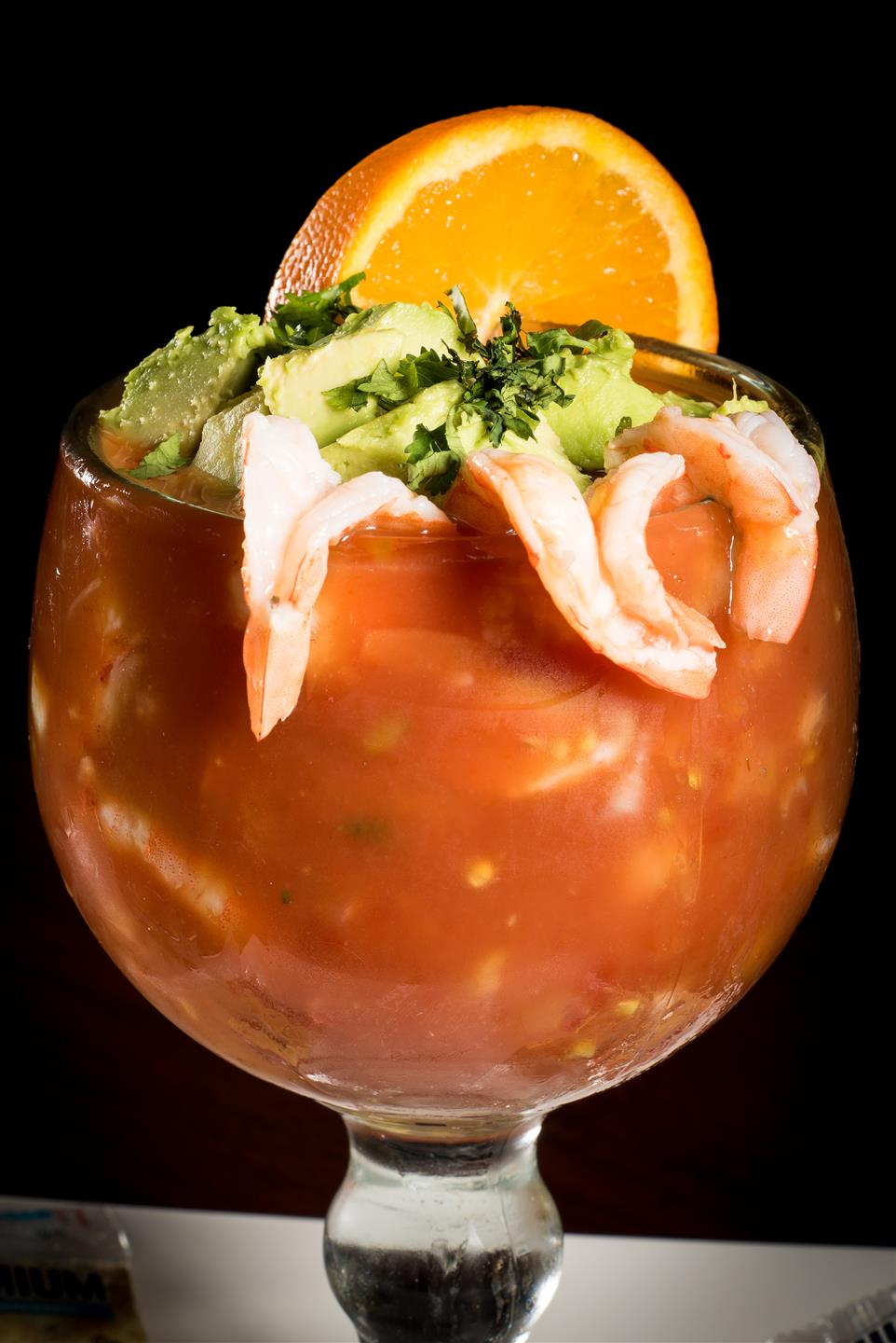 Shrimp Cocktail: Served with homemade cocktail sauce, chopped tomatoes, onions, cilantro and avocado