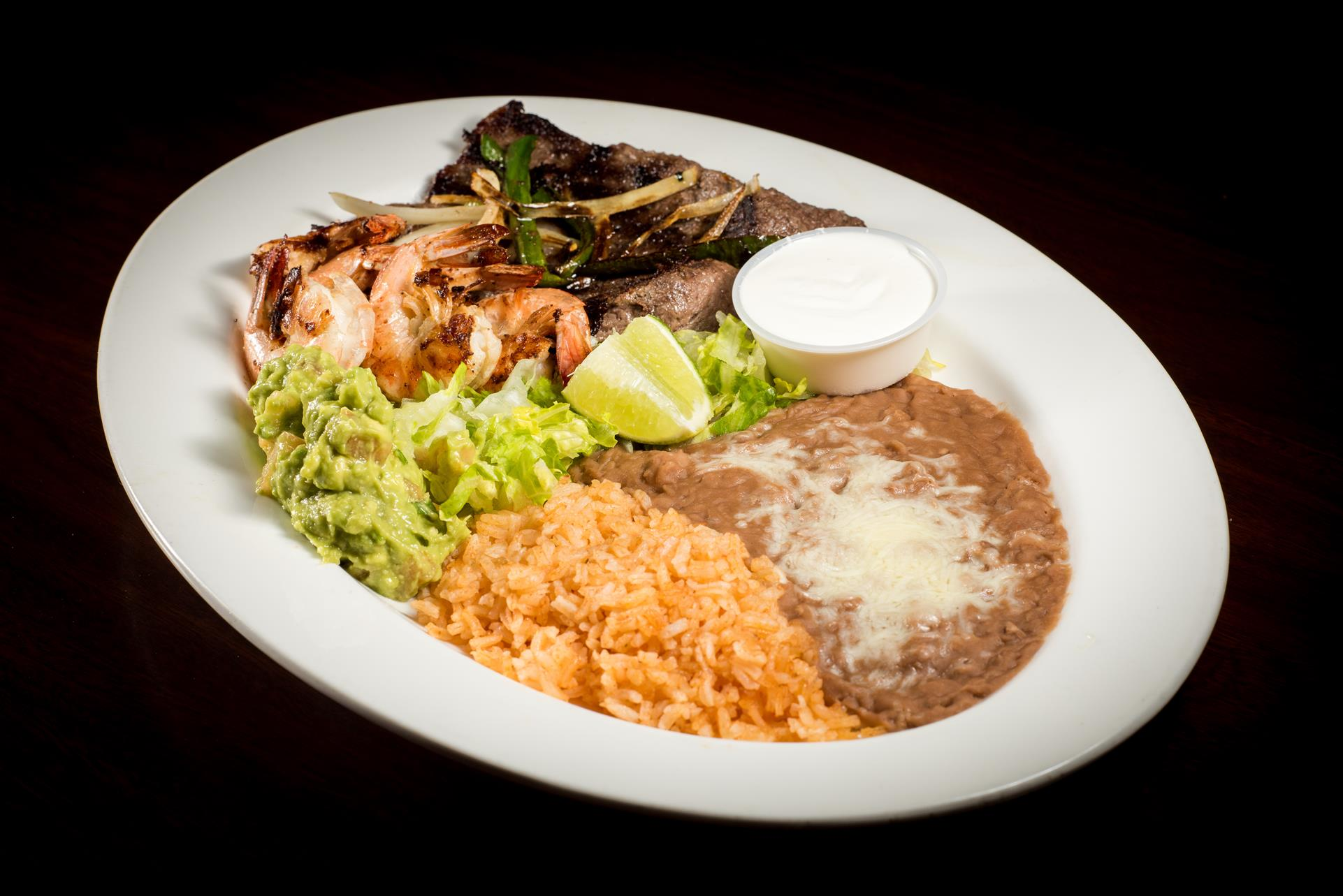 Steak & Shrimps Platillo: Grilled shrimp and grilled thin sliced of steak. Served with guacamole and sour cream