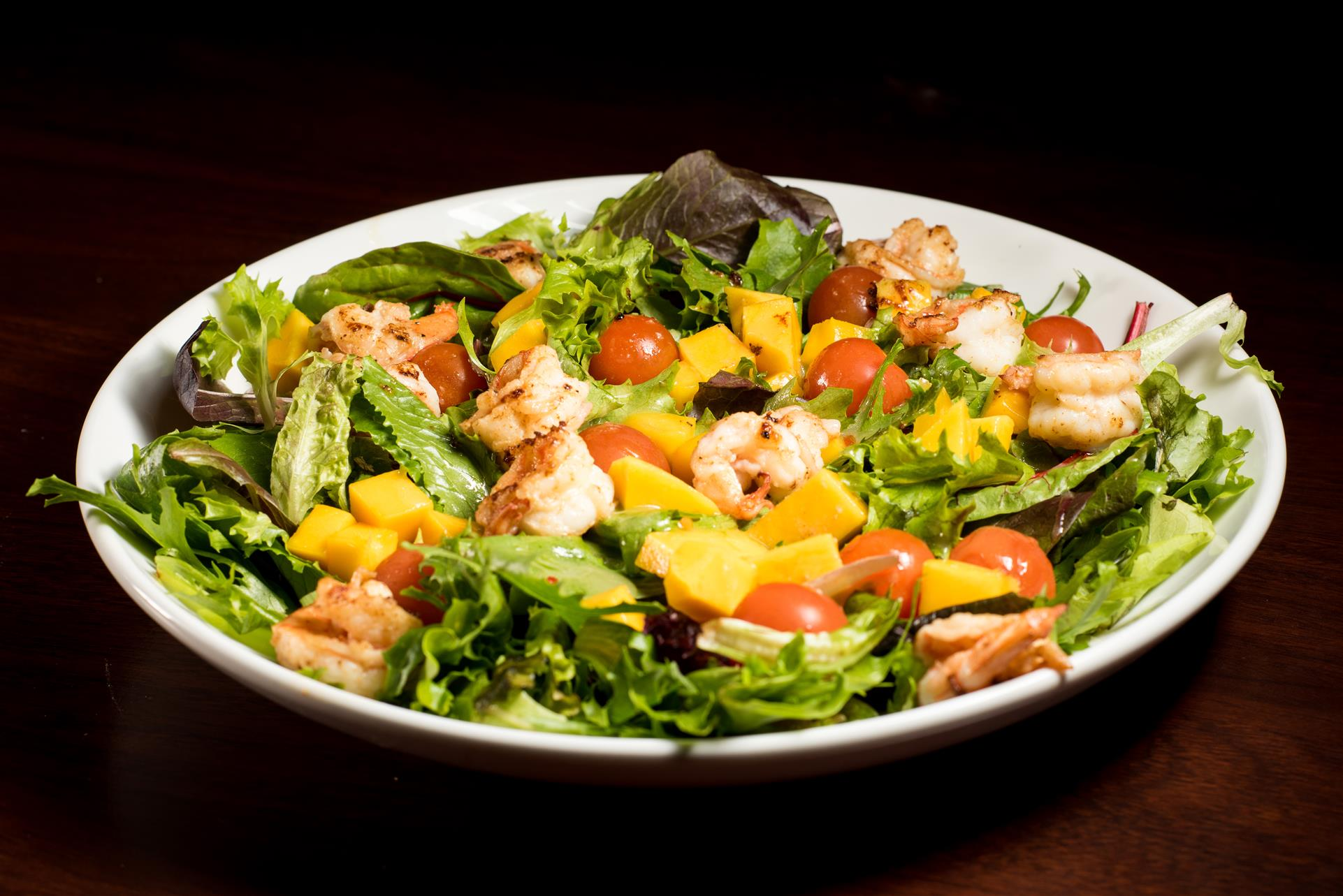 Shrimp Salad: Grilled shrimp with spring lettuce mix, mango vinaigrette, tomatoes and fresh mango cubes.