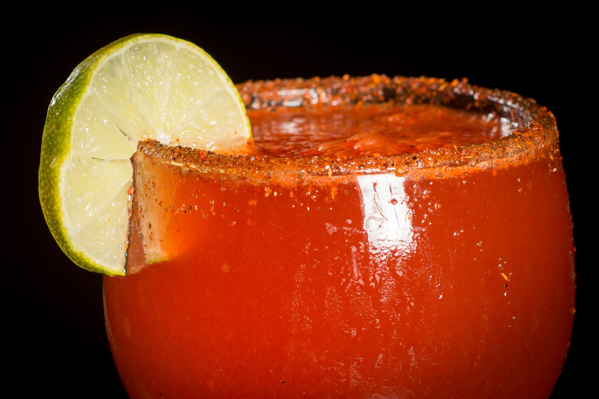 Michelada cocktail with a lime