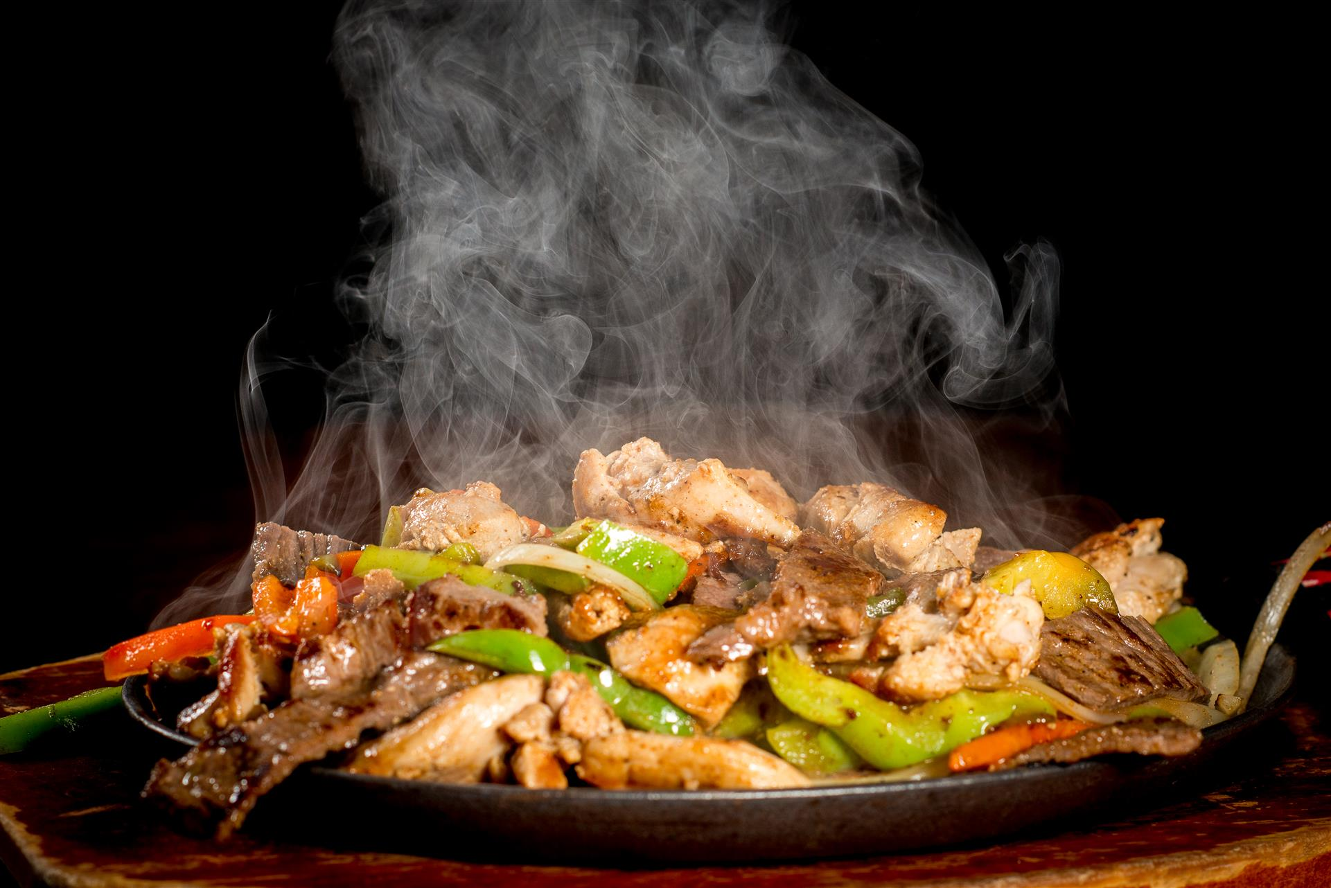 Mixed Fajita: Chicken, beef and shrimp with peppers and onions