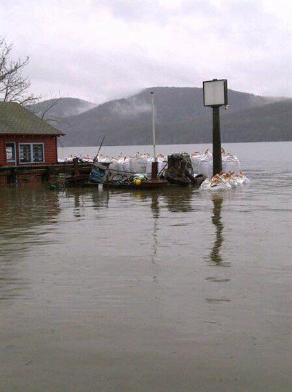 outside of the restaurant flooded with floating debris