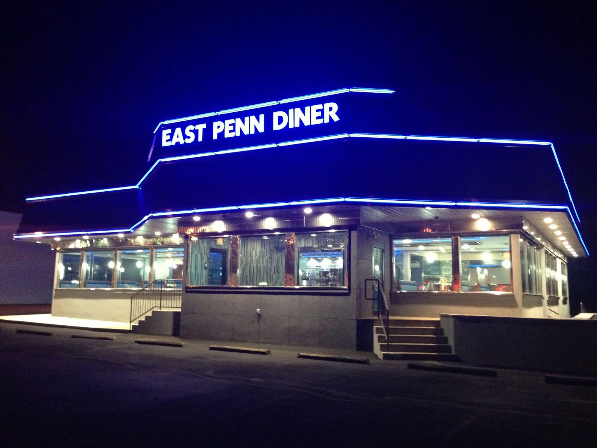 exterior of the restaurant with neon sign