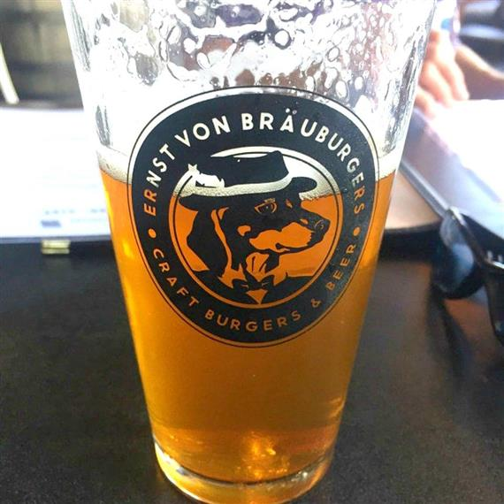 Ernst Von Brauburgers pint glass half full of beer
