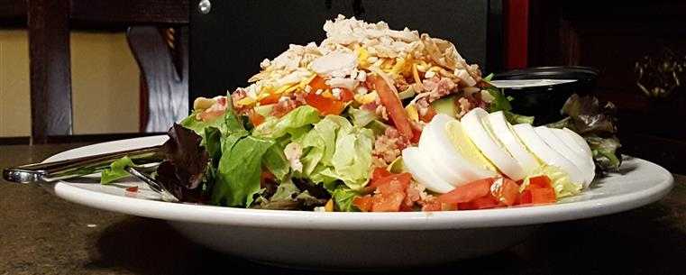 Fox Cobb Salad: Smoked turkey, crisp bacon, egg, tomato, cucumber, red pepper, blue cheese crumbles