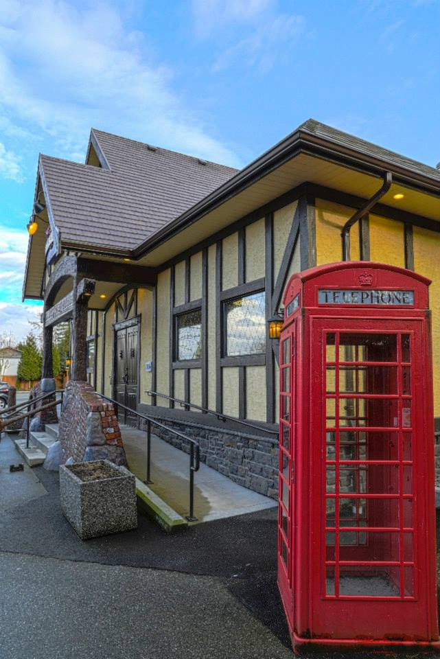 outside of fox & hound with a telephone