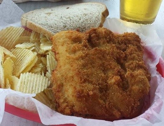 fried fish with chips and bread on the side