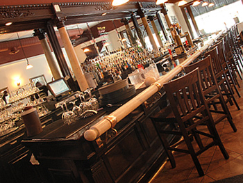 view of the bar with wood furniture
